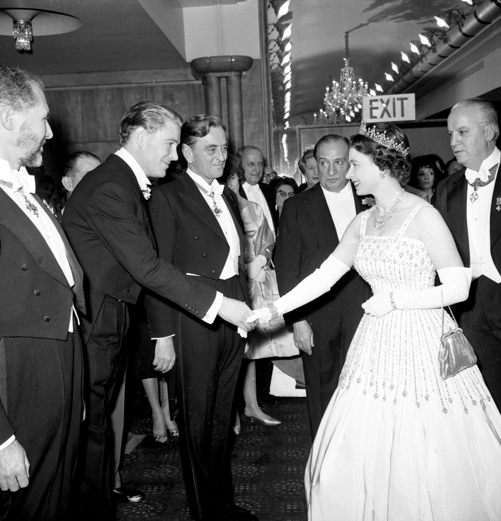 Princess Beatrice wedding. File photo dated 10/12/62 of Queen Elizabeth II arriving at the Odeon, Leicester Square, London for the world charity premiere of the film 'Lawrence of Arabia'. The Queen is wearing the same Peau De Soie taffeta dress by Norman Hartnell that was worn by Princess Beatrice at her wedding to Edoardo Mapelli Mozzi on Friday. Issue date: Saturday July 18, 2020. See PA story ROYAL Beatrice. Photo credit should read: PA/PA Wire URN:54642678 (Press Association via AP Images)