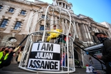 Julian Assange extradition case. Fashion designer and businesswoman Dame Vivienne Westwood is suspended in a ten foot high bird cage outside the Old Bailey in London to protest against the US extradition of Julian Assange. Picture date: Tuesday July 21, 2020. See PA story LEGAL Assange. Photo credit should read: Victoria Jones/PA Wire URN:54673147 (Press Association via AP Images)