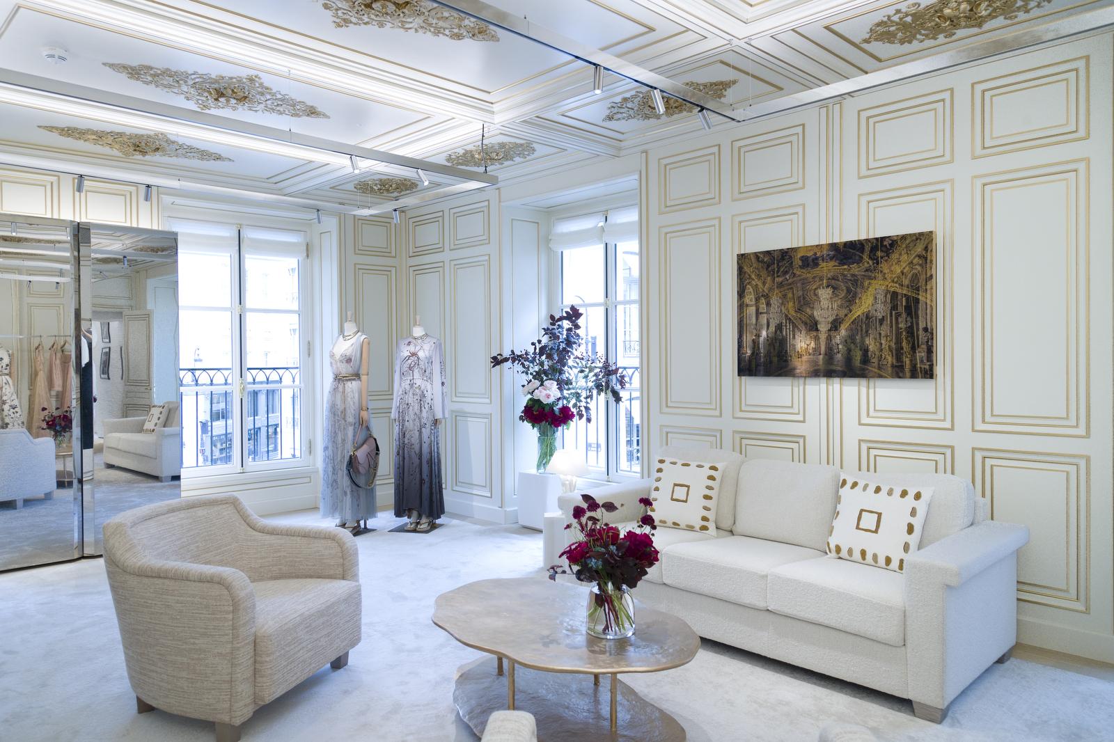 Eveningwear is showcased in a gilded salon.