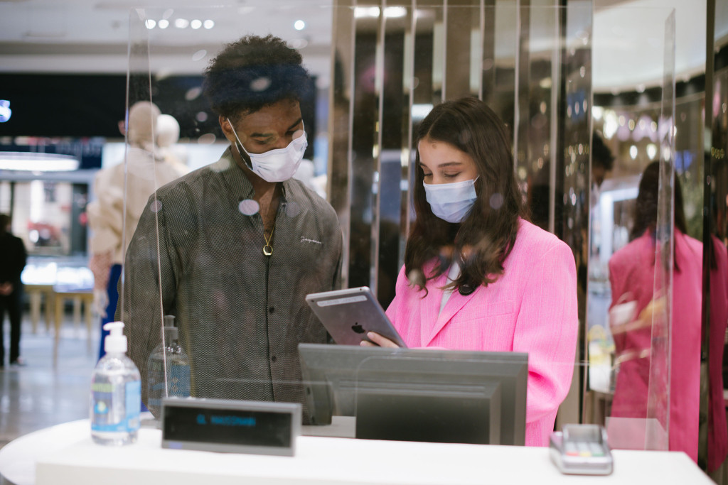 people with face masks in store
