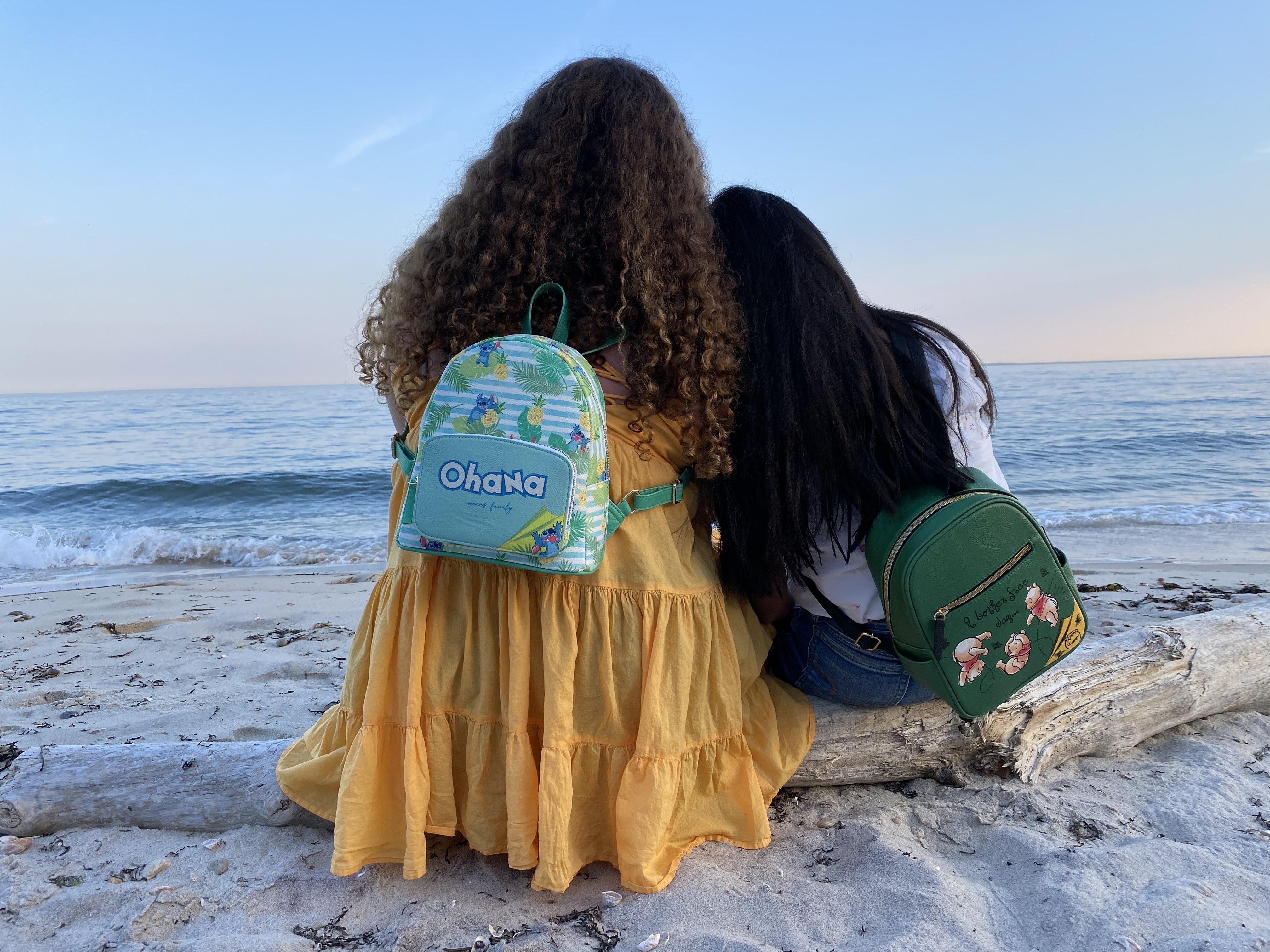 Dani by Danielle Nicole backpacks depict Disney characters.