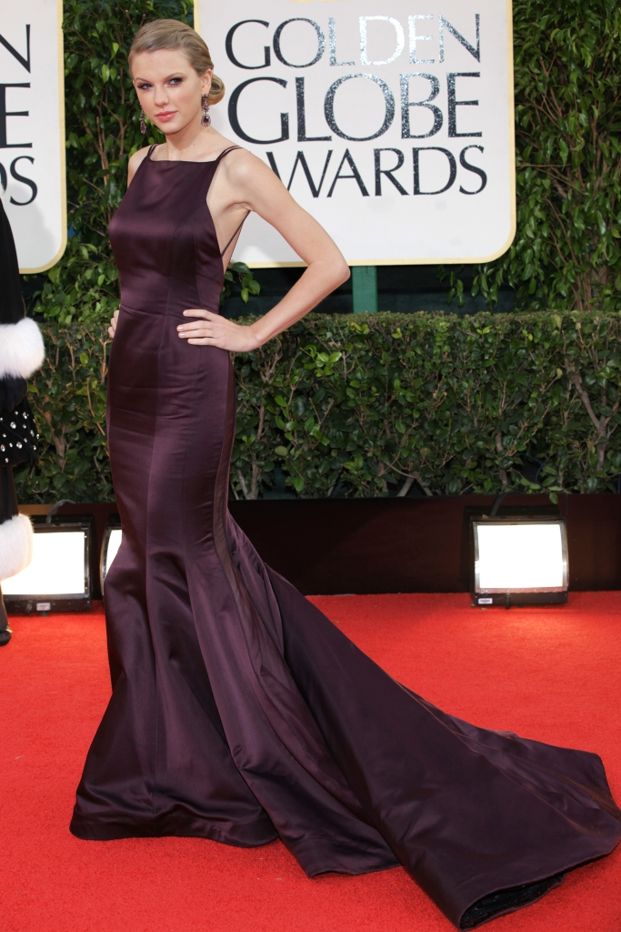 Taylor Swift attends the 70th annual Golden Globe Awards at the Beverly Hilton. Swift wears Donna Karan Atelier with Lorraine Schwartz jewelry, an Orton clutch and Rene Caovilla shoes.