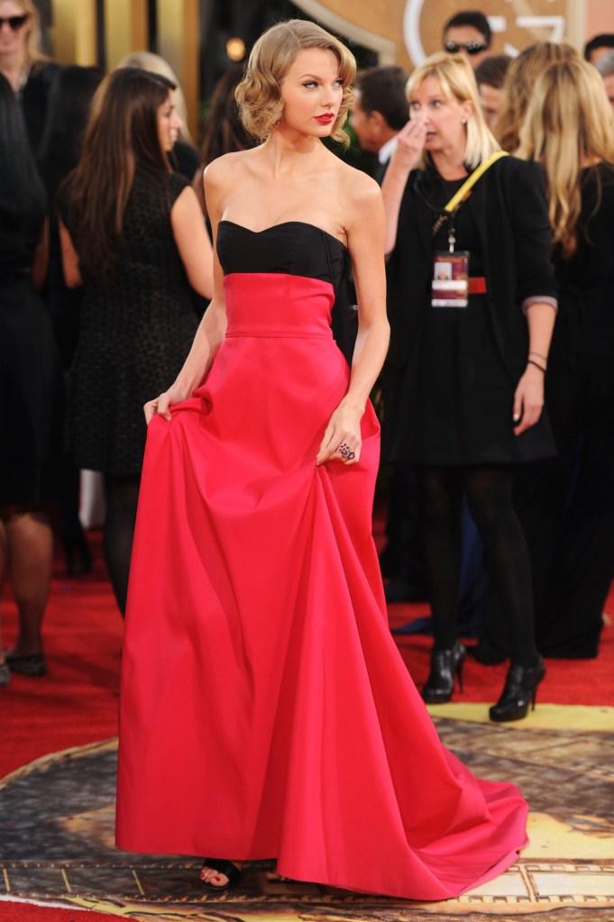Taylor Swift attends the 71st annual Golden Globe Awards at the Beverly Hilton. Swift wears Carolina Herrera.