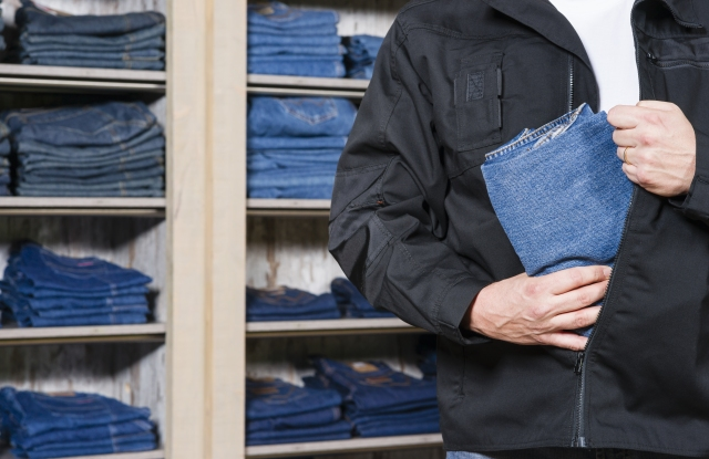 man stealing jeans