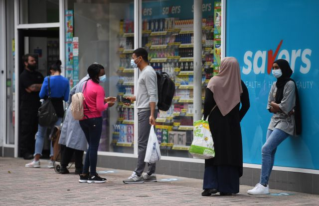 People wear face masks as they shop in Leicester city centre in Leicester, Britain, 30 June 2020.The City of Leicester is the first city in the UK to have to go into local lockdown after 10 percent of all new recorded cases in the UK in the past week were in the city. All non-essential shops in the city will close from 30 June and schools will close to most pupils from 02 July on. Pubs, restaurants, places of worship and other businesses will now remain closed for longer and not re-open on 04 July like the rest of the country.Coronavirus in Britain, Leicester, United Kingdom - 30 Jun 2020