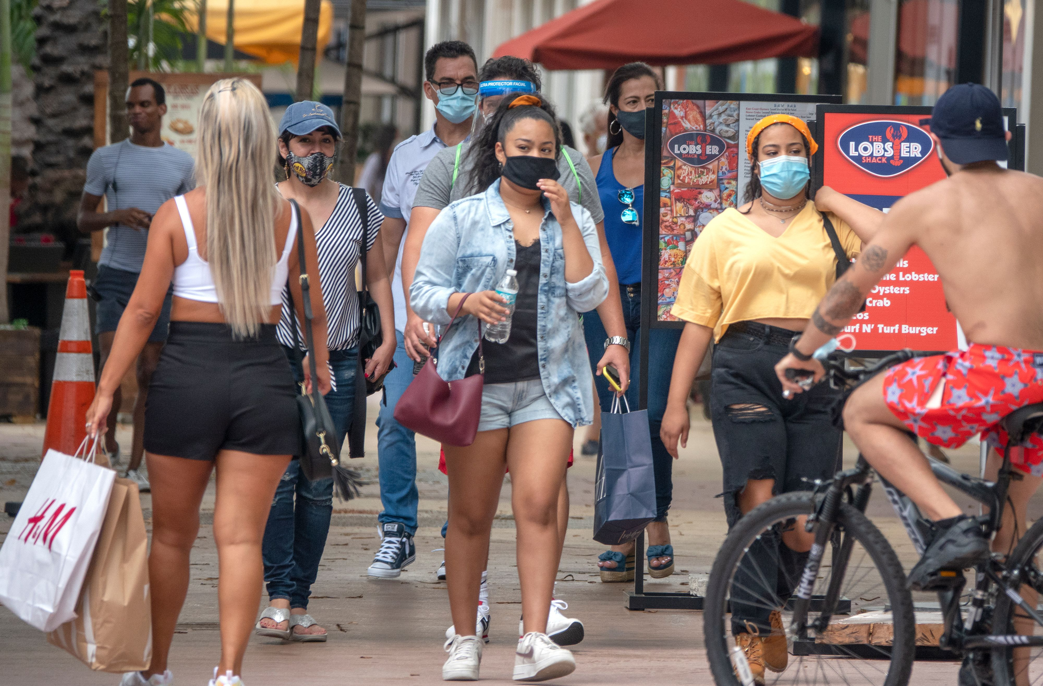 People walk through Lincoln Road section of Miami on July 12, as Florida has seen days of record breaking numbers of new coronavirus cases.