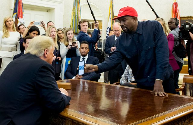 kanye west in oval office with president donald trump cameras (R) shows a cell phone depicting the image of an aircraft to US President Donald J. Trump (L) during their meeting in the Oval Office of the White House in Washington, DC, USA, 11 October 2018. West, who is a Trump supporter, met with the President to discuss prison reform and other issues.US President Donald J. Trump meets with US entertainer Kanye West and retired football player Jim Brown, Washington, USA - 11 Oct 2018