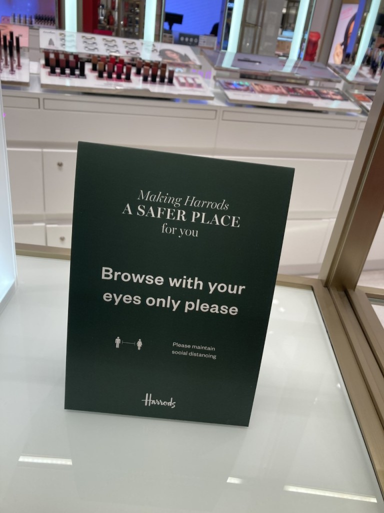A sign in Harrods' beauty hall asking customers not to touch the merchandise.