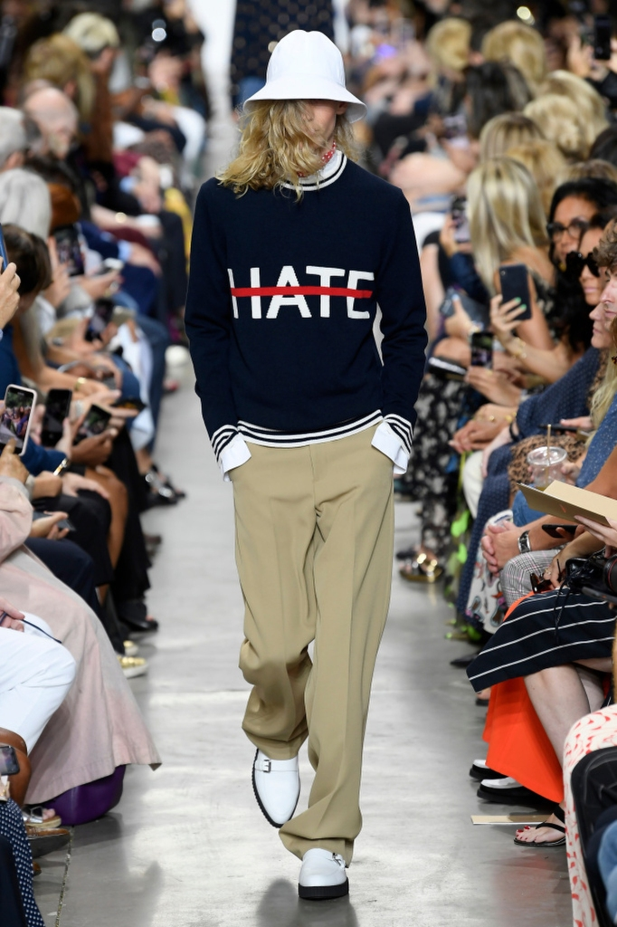 """""""We need love, and we need to cancel out the hate,"""" Kors told clients at his company trunk show in May. This spring sweater has """"a wonderful message."""""""