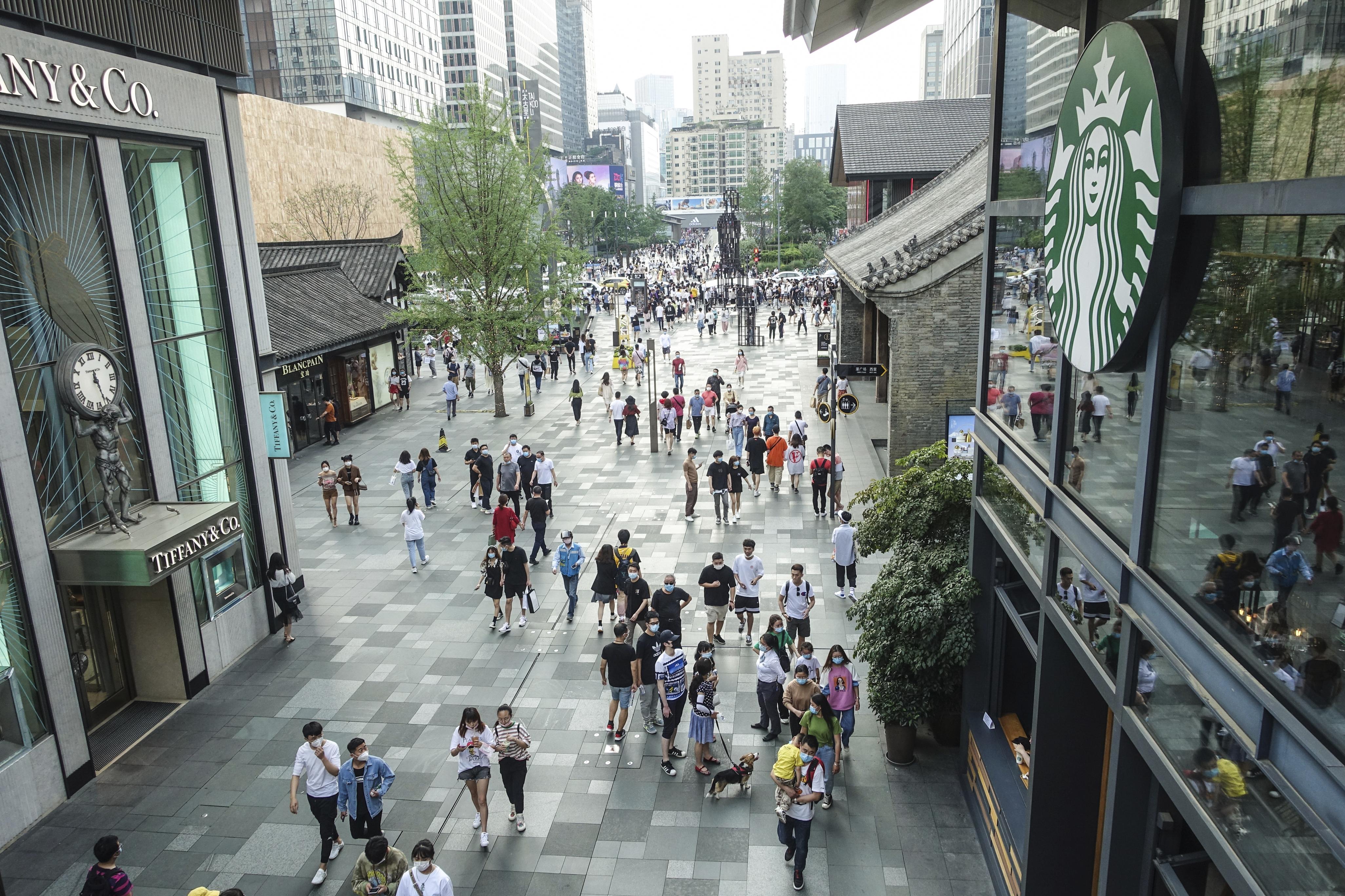 People walk around at Sino-Ocean Taikoo Li, a mixed-use development in Chengdu.
