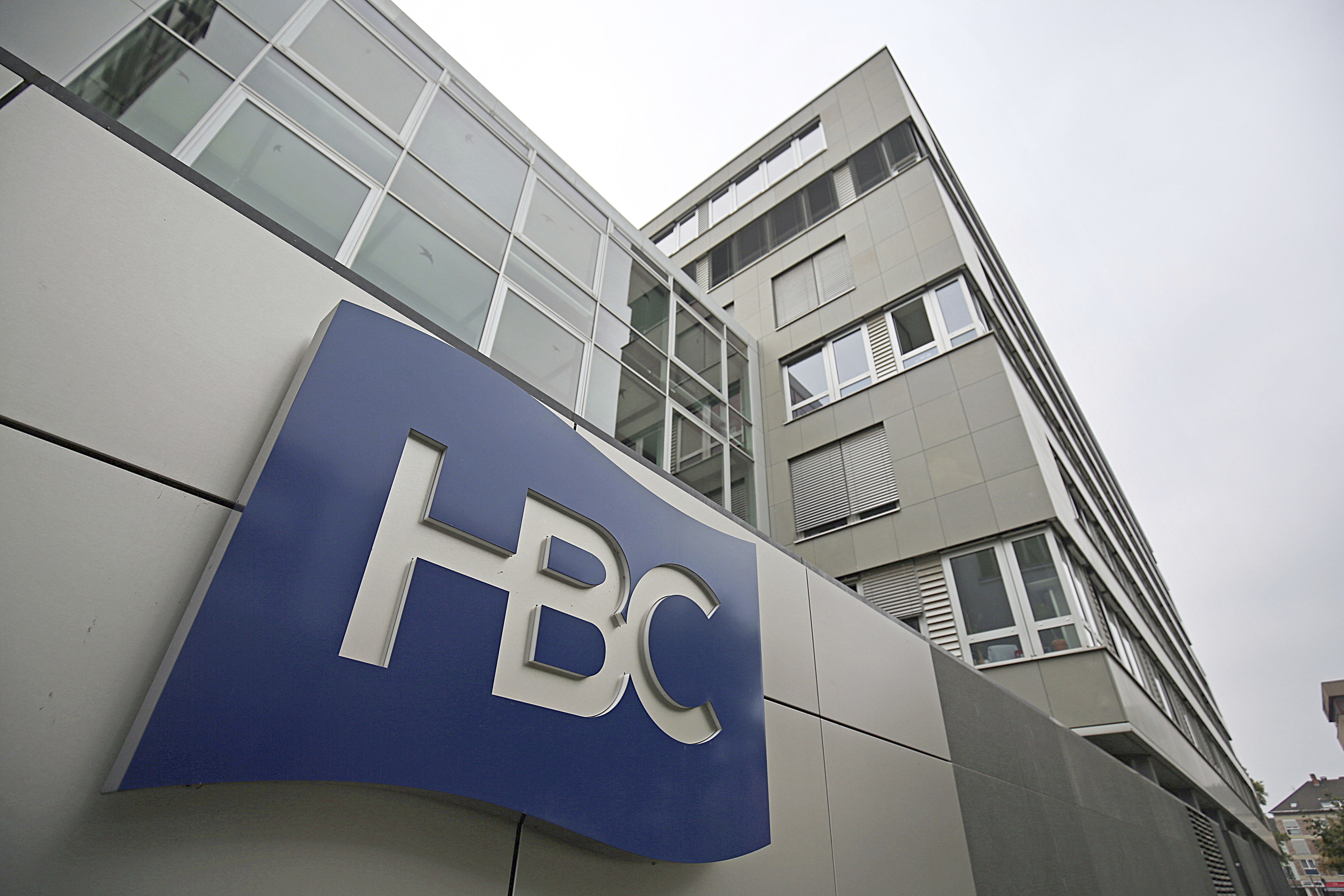 """06 September 2018, Germany,, Cologne: The logo of the Kaufhof parent company, the Canadian Hudson's Bay Company (HBC), is attached to the German headquarters. The planned merger of the Karstadt and Kaufhof department store chains has cleared an important hurdle. The banks had approved the merger of the two retail chains, the """"Sueddeutsche Zeitung"""" reported on 6 September 2018. Photo by: Oliver Berg/picture-alliance/dpa/AP Images"""