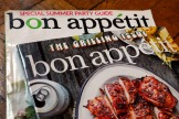 """Two covers of Bon Appetit magazine are shown in this photo, in New York, Wednesday, June 10, 2020. The staff at Bon Appetit, whose top editor resigned after a revolt by the journalists there after an offensive photo of him circulated online amid longstanding issues over treatment of people of color, said in a statement Wednesday, June 10,  that """"our mastheads have been far too white for far too long"""" and the magazine was making changes. (AP Photo/Richard Drew)"""