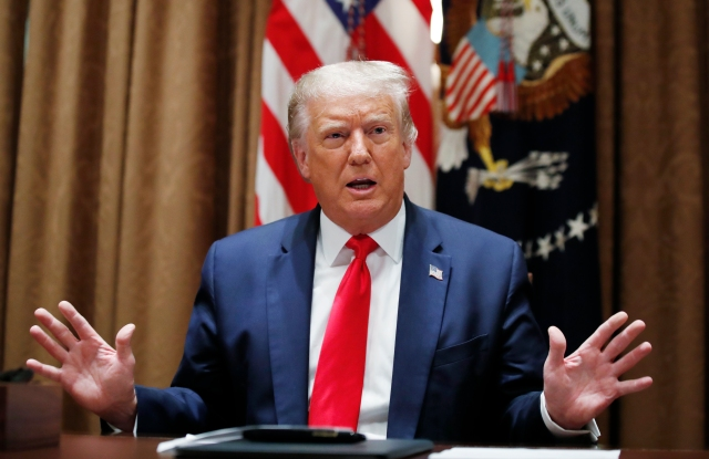 President Donald Trump speaks during a meeting with U.S. tech workers, before signing an Executive Order on hiring American workers, in the Cabinet Room of the White House, Monday, Aug. 3, 2020, in Washington.(AP Photo/Alex Brandon)
