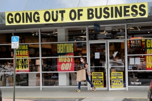 A customer leaves a Pier 1 retail store, which is going out of business, during the coronavirus pandemic, Thursday, Aug. 6, 2020, in Coral Gables, Fla. The home goods retailer is going out of business and is permanently closing all of its stores. (AP Photo/Lynne Sladky)