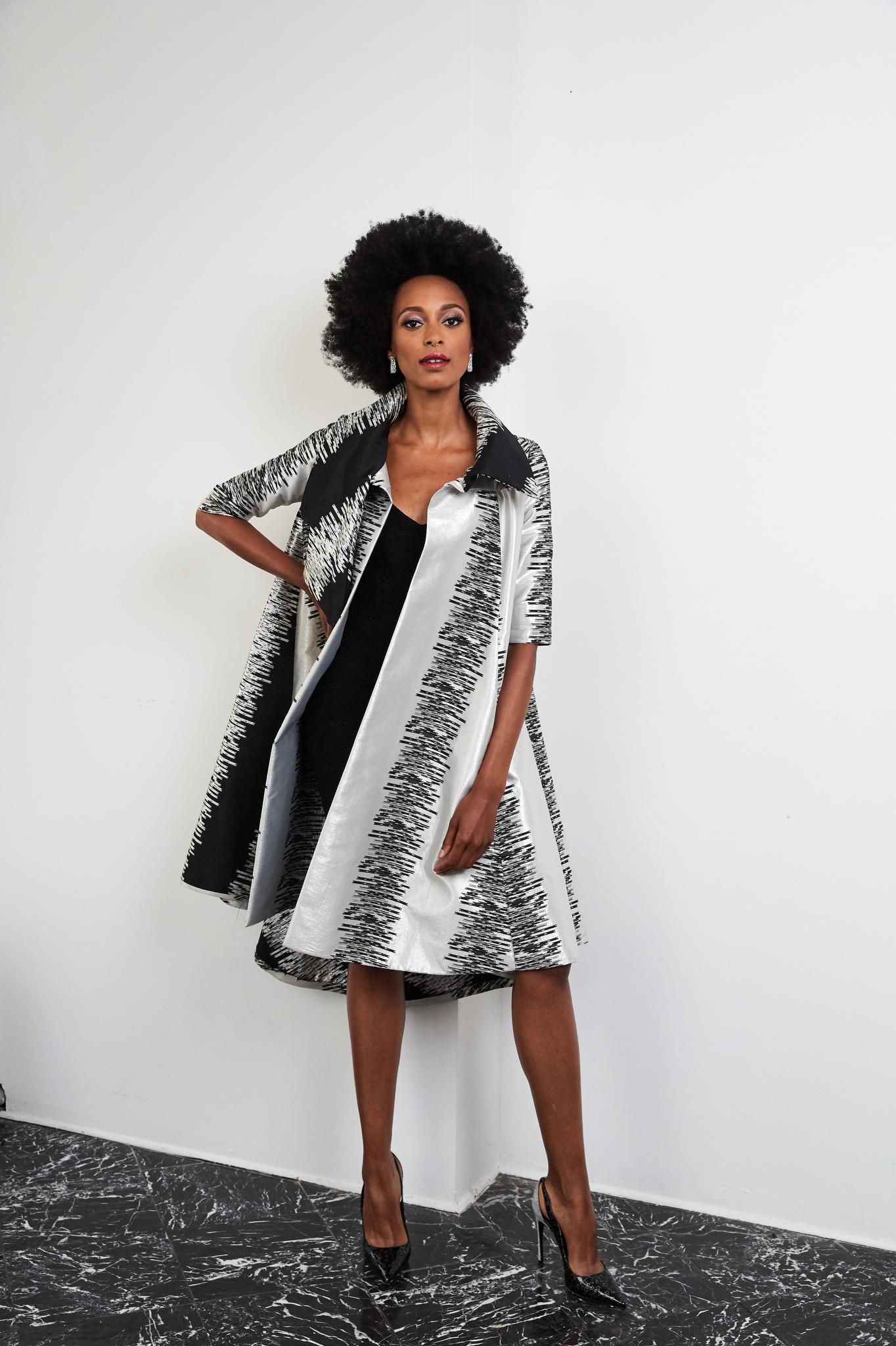 A Big Sweep: B Michael's metallic silk brocade coat.