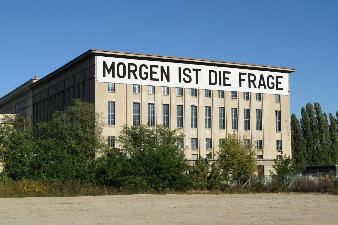 A rendering of Berghain in Berlin plastered with a word-based artwork by Rirkrit Tiravanija.