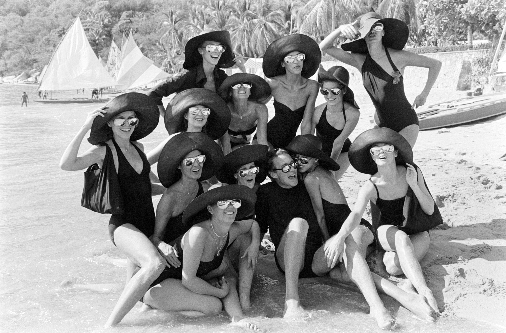 Designer Roy Halston and the Halstonettes in Acapulco, Mexico.