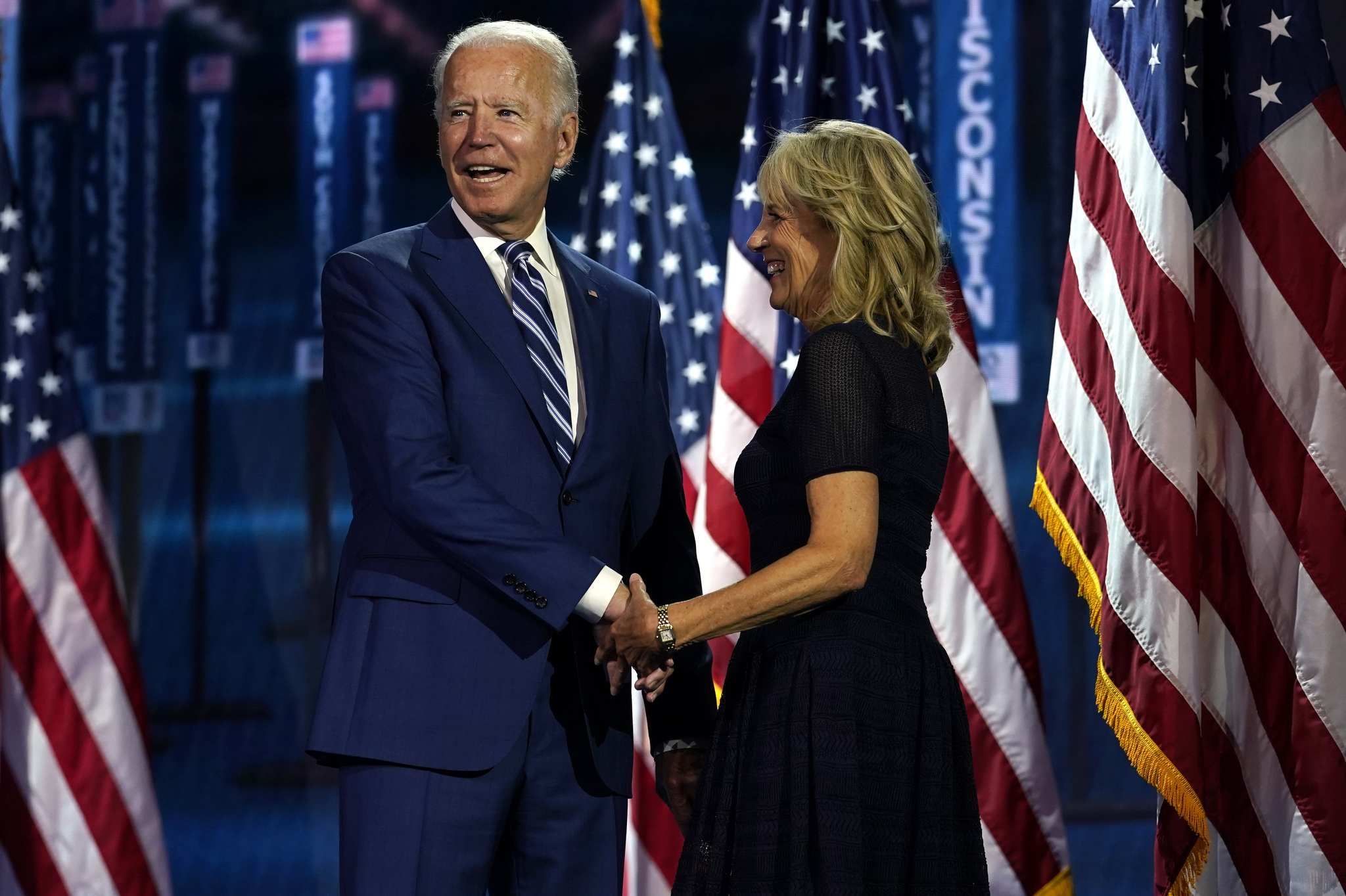 Democratic presidential candidate Joe Biden, and his wife Jill Biden, take the stage during the third day of the Democratic National Convention.