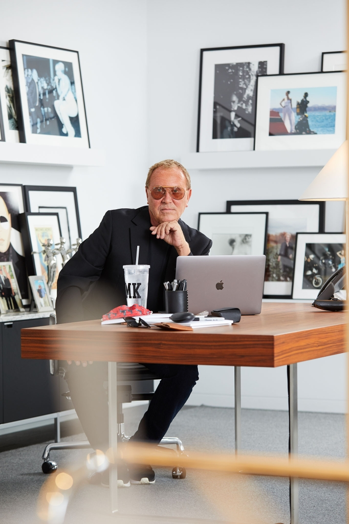 """Alone at his desk, Kors can lose the mask. Getting back to the office was essential for Kors, and about 20 percent of the staff, """"a mix of people,"""" he said, """"who really need to get their hands on things, so to speak."""""""
