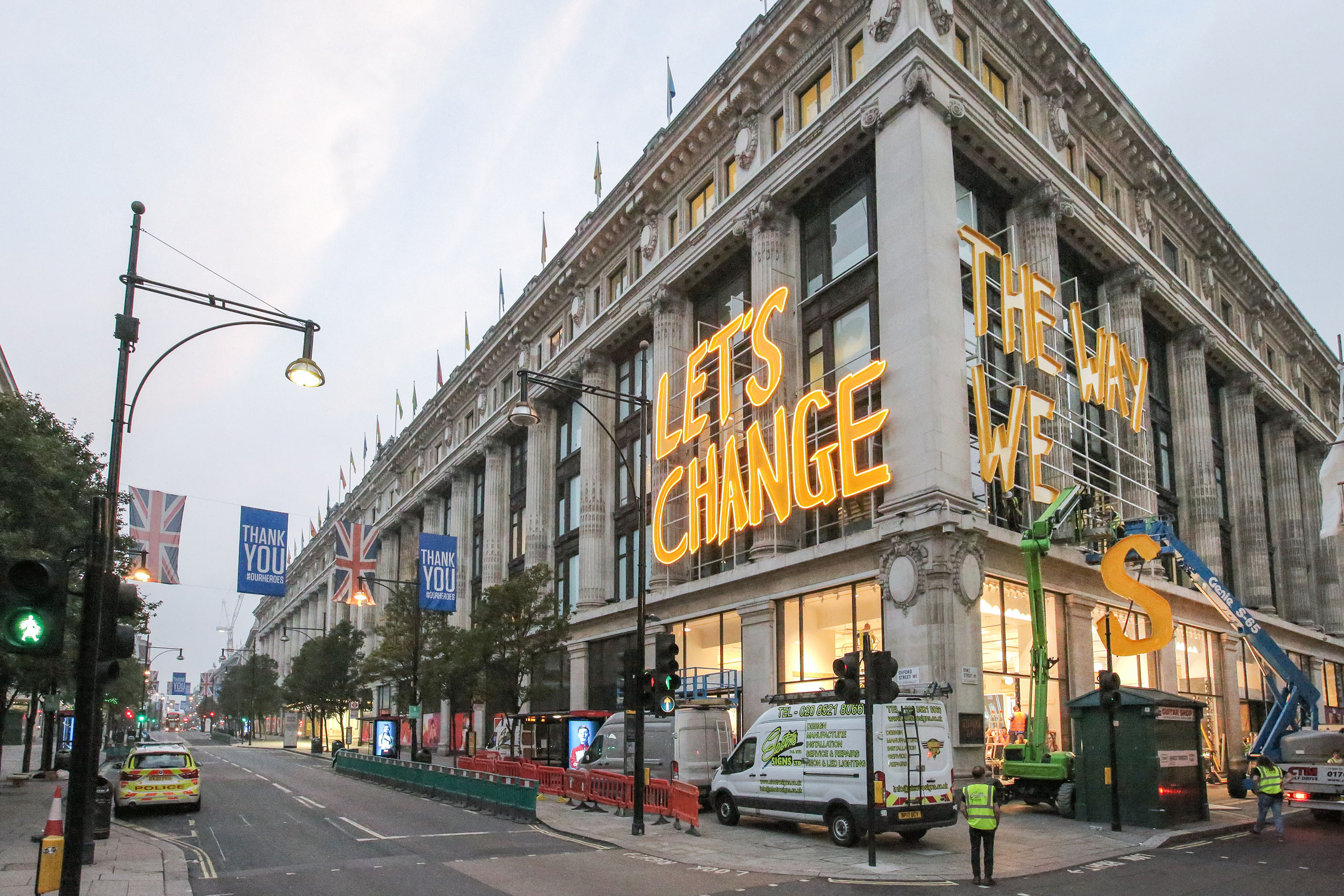 Signage specialists install 'Let's Change The Way We Shop' sign ahead of the unveiling of Selfridges' transformational sustainability initiative, Project Earth, with five year commitments to change the way we shop. Launching tomorrow, Monday 17 August.
