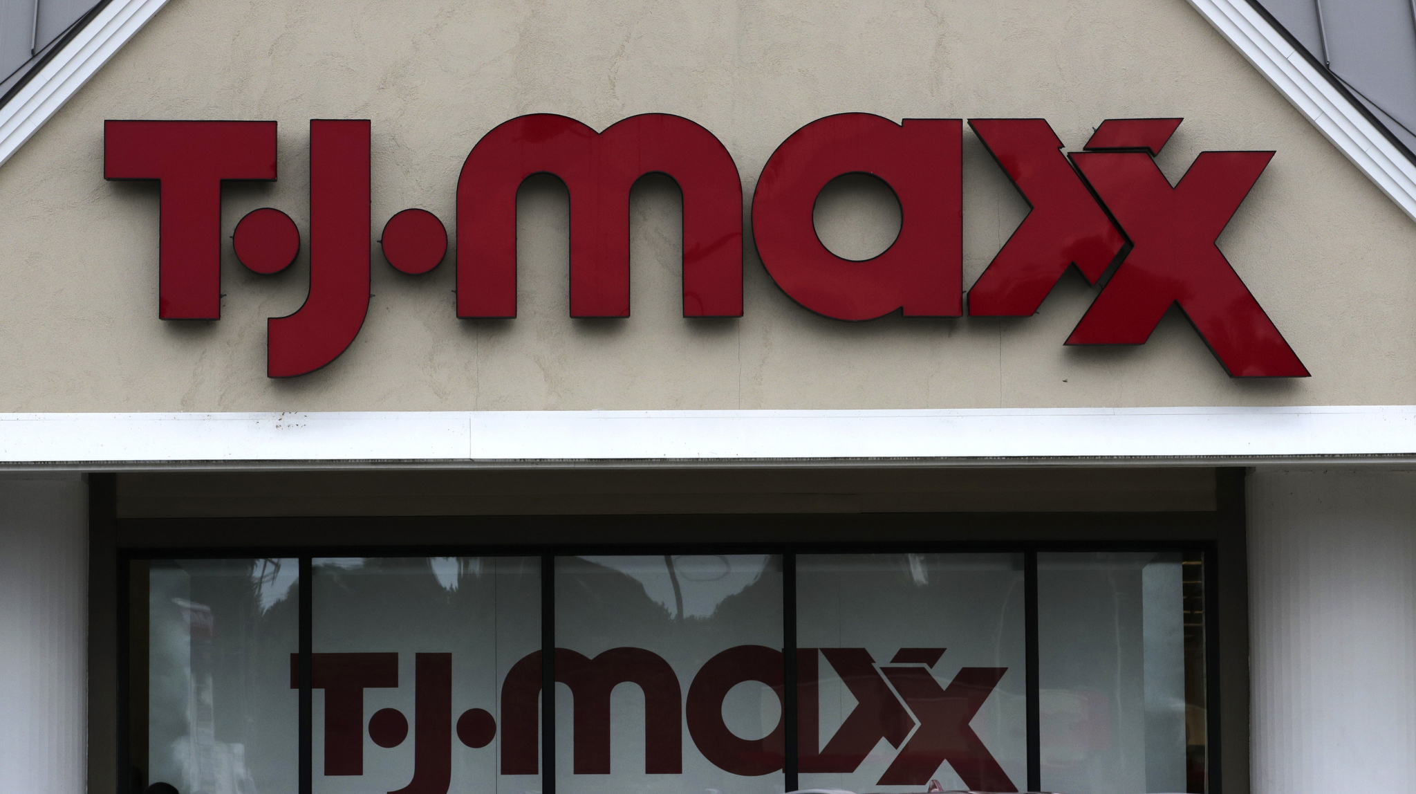 TJ Maxx logo on a store in Manchester, N.H.