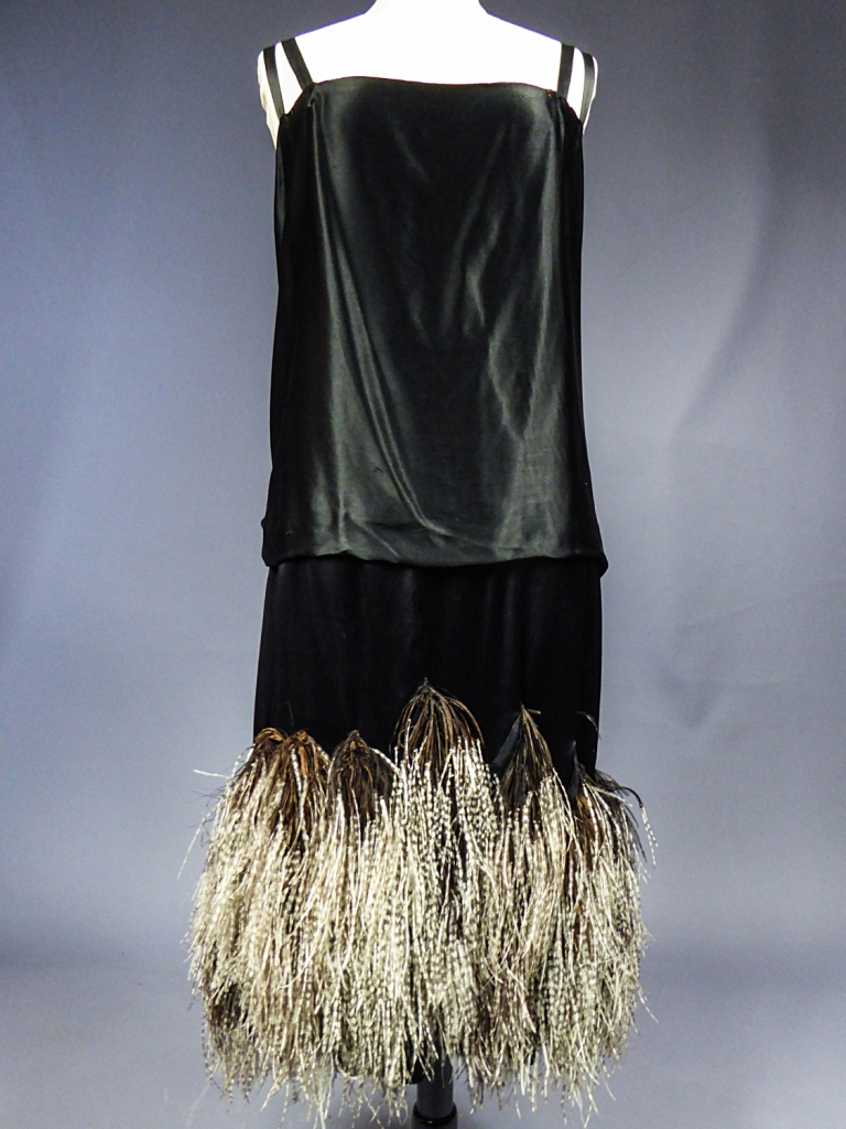 "A dress by Charles Frederick Worth in the ""Man Ray and Fashion"" exhibition in Paris."