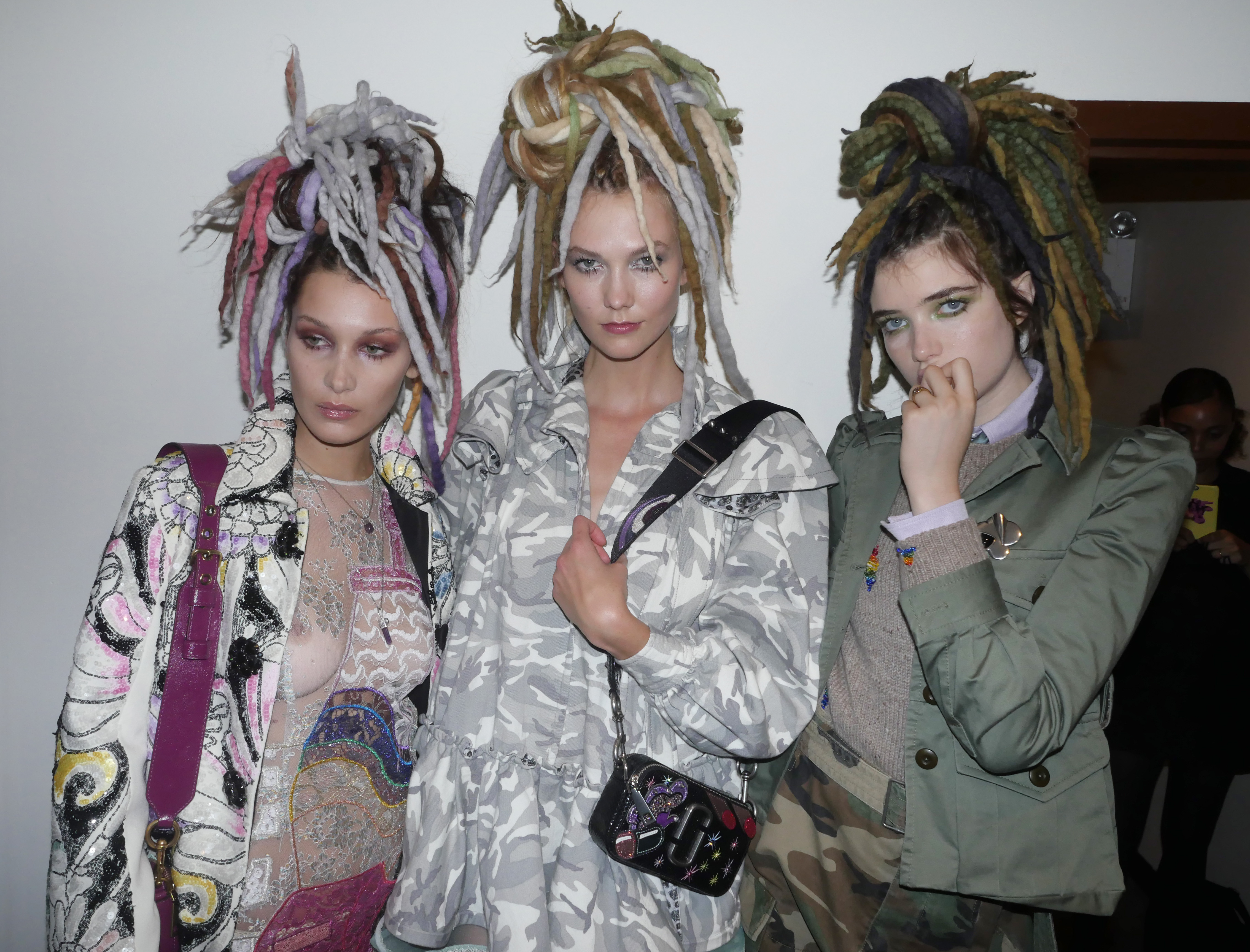Bella Hadid, Karlie Kloss and Grace Hartzel backstage at the Marc Jacobs spring 2017 runway show in dreadlock wigs, which Jacobs apologized for after the show.