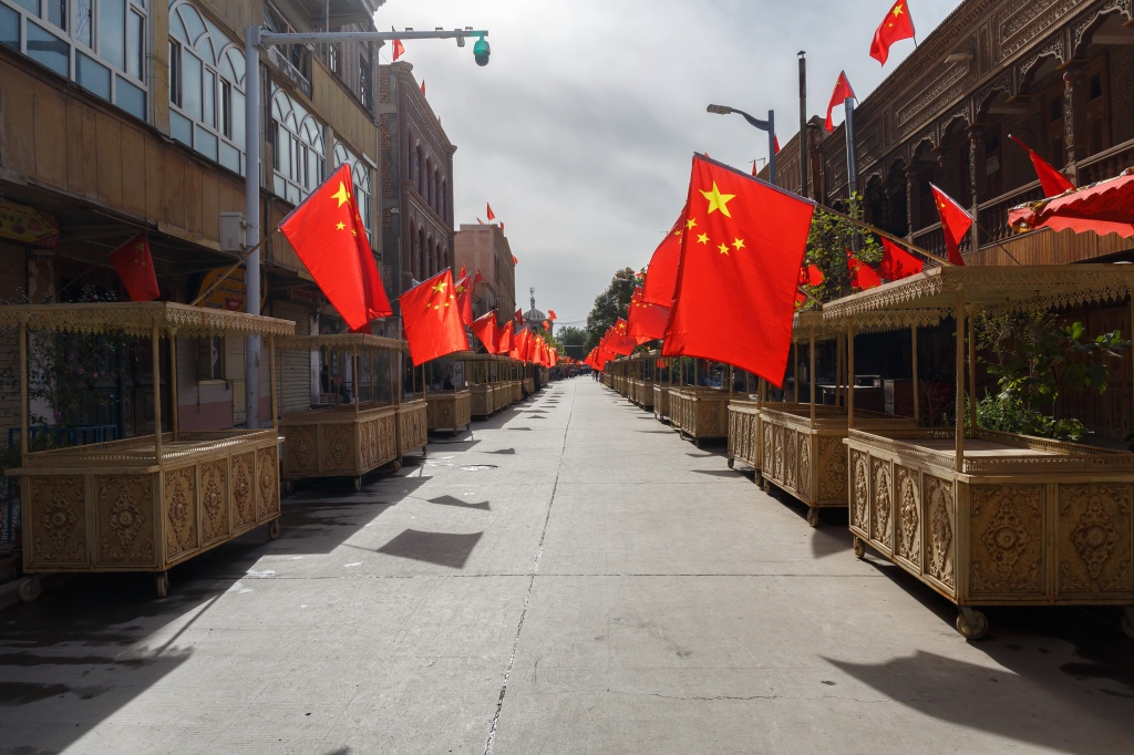 street in xinjiang chinese flags