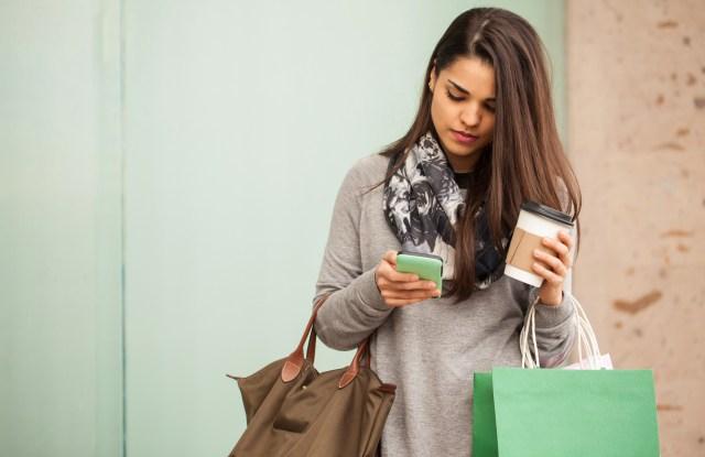 latinx hispanic woman shopping cell phone