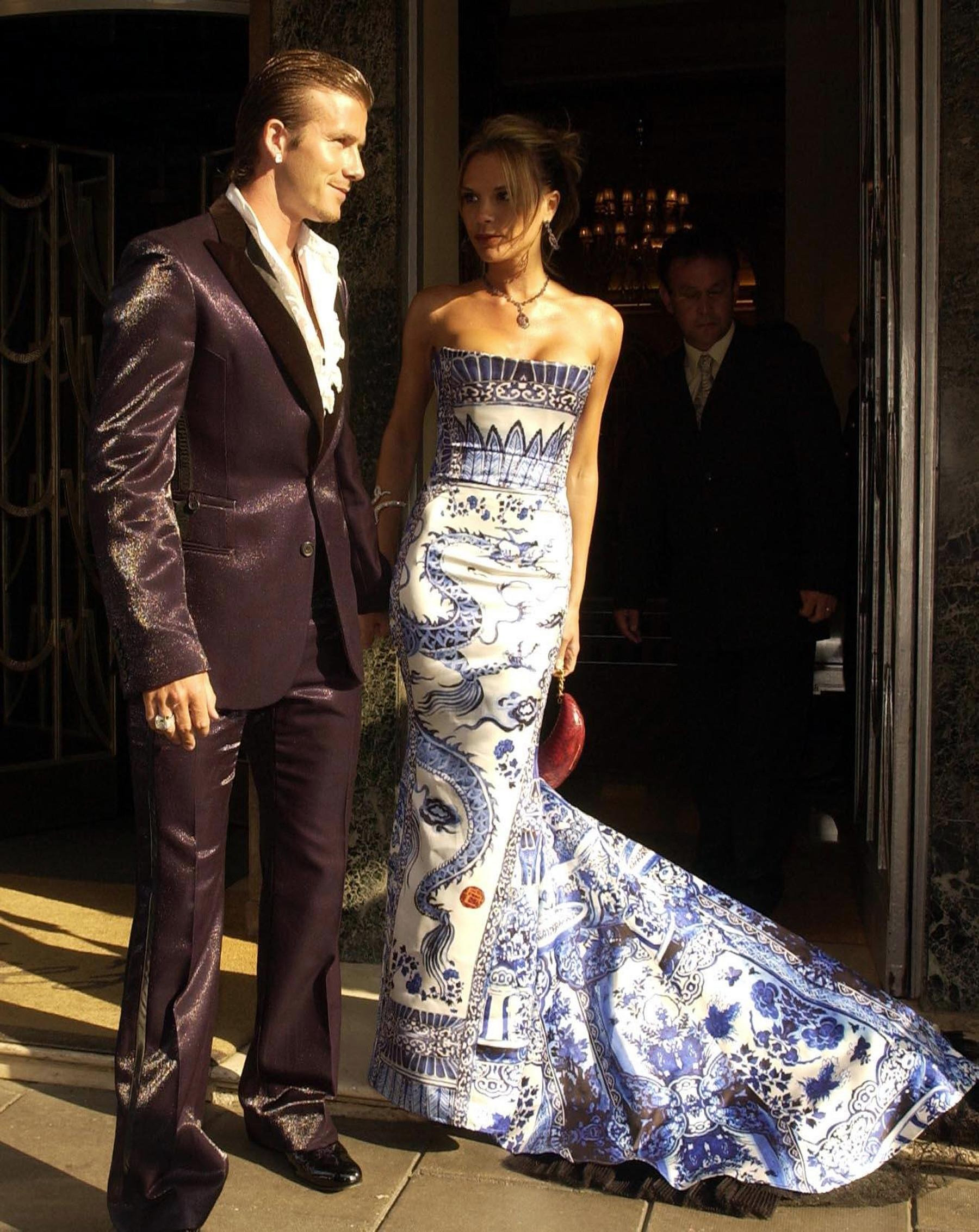 David Beckham with his wife Victoria in a Roberto Cavalli gown inspired by the Chinese blue-and-white porcelain.