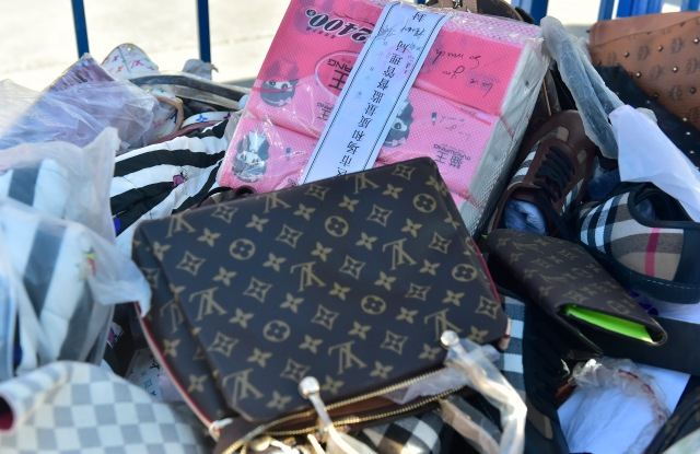 The counterfeits of luxury bags are to be smashed on the World Consumer Rights Day.