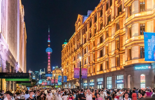 Crowds walking Nanjing Road East, a popular pedestrian strip in Shanghai on Sep. 13, 2020.