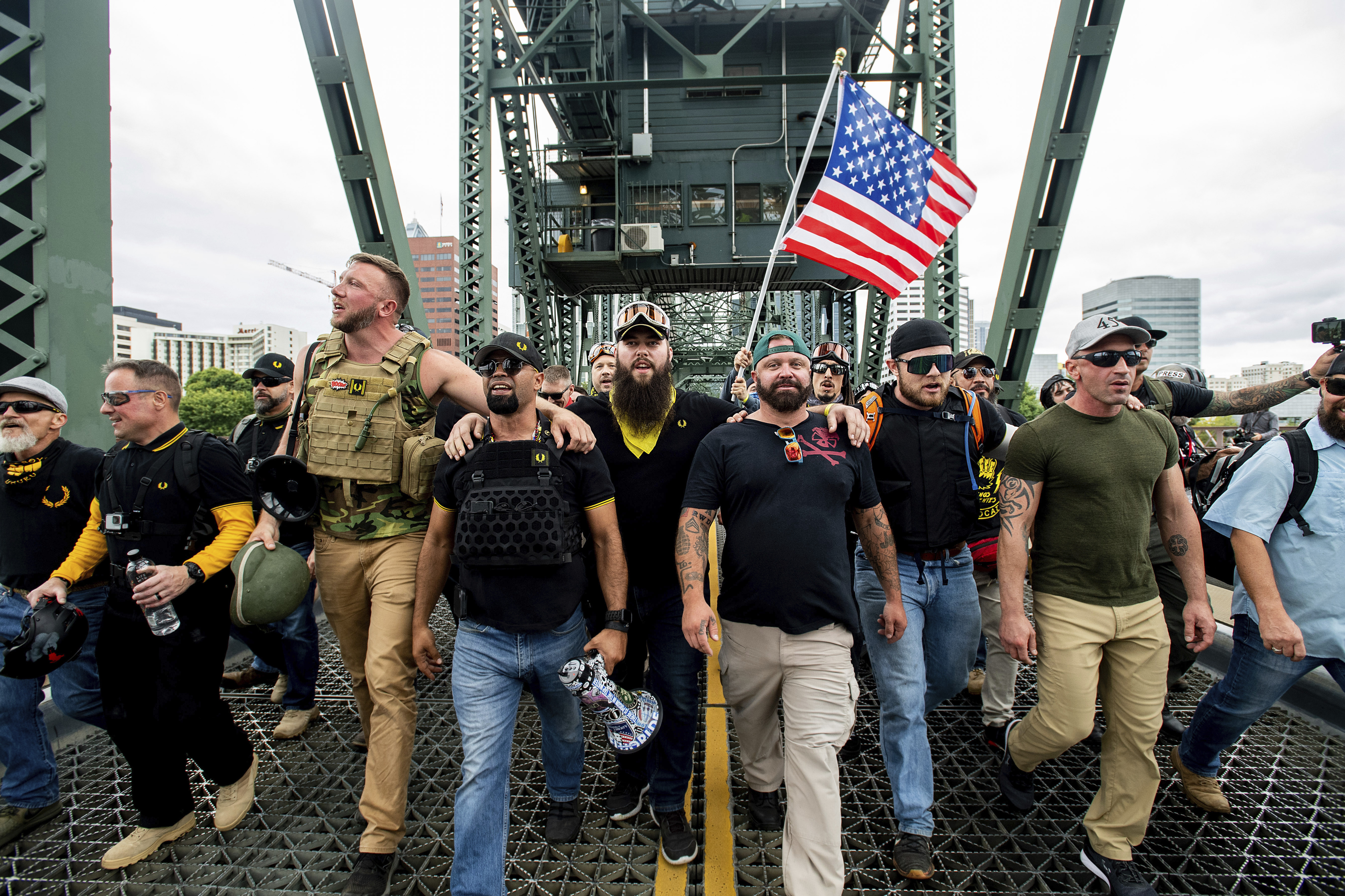Members of the Proud Boys and other right-wing demonstrators march across the Hawthorne Bridge during a rally in Portland.