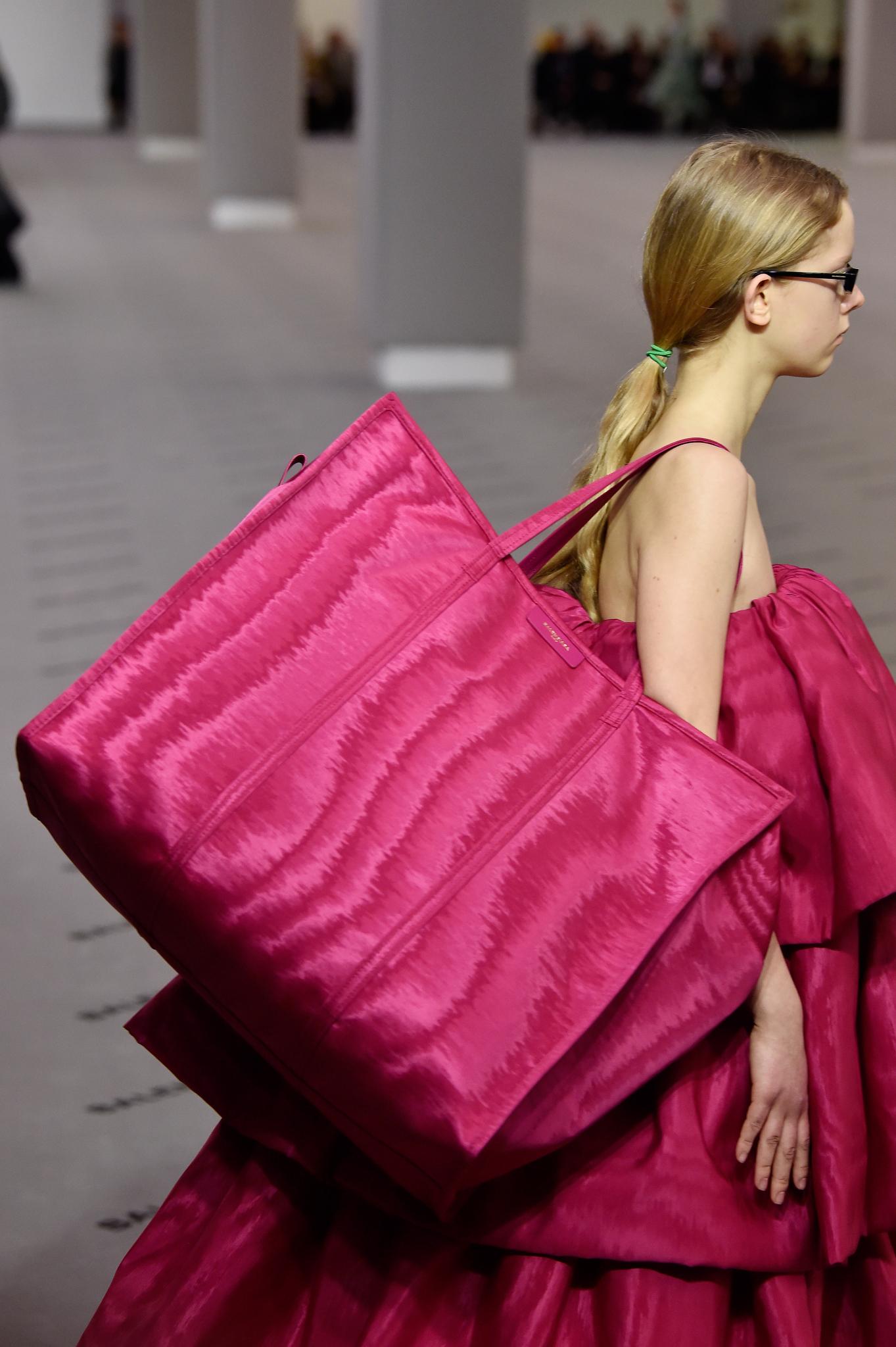 Model on the catwalk, bag detail