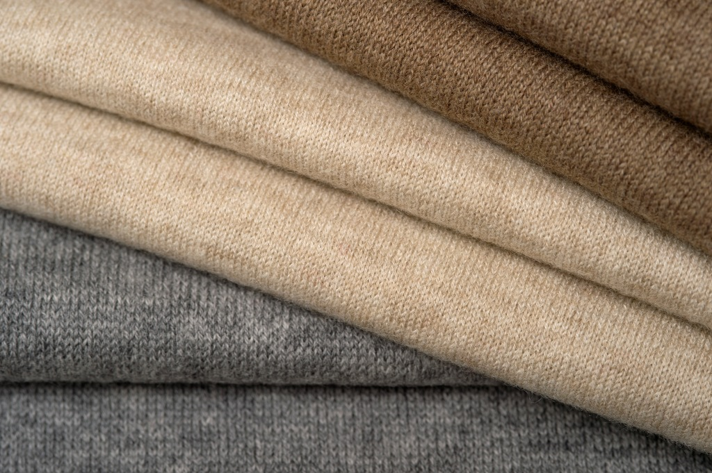 Fabrics crafted from Botto Giuseppe green cashmere fall 2021 yarns.