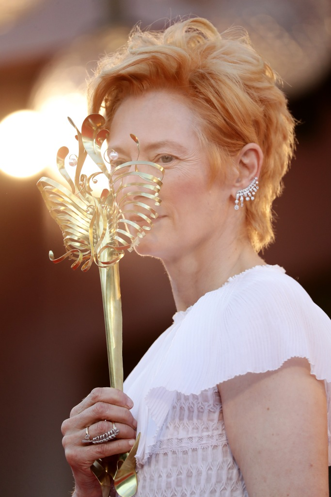 Actress Tilda Swinton walks the red carpet ahead of the Opening Ceremony at the 77th Venice Film Festival.