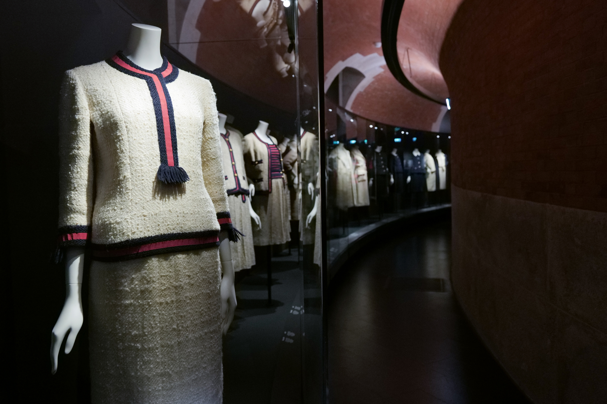 """Caption: Chanel tweed suits are displayed in the new """"Gabrielle Chanel Galleries"""" at Palais Galliera."""