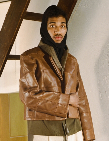 A cognac patchwork leather jacket by Connor McKnight.