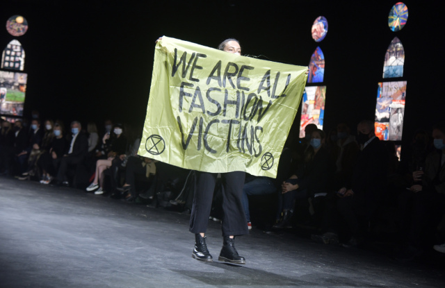 A protester at the Dior spring 2021 show.