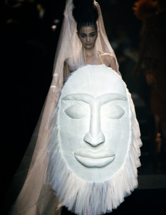 An African Tribal inspired shield-bouquet couture bridal ensemble designed by Jean Paul Gaultier for Spring 2005.