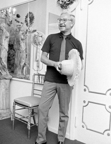 Designer Adolfo poses at his New York City atelier with a hat design from his Summer 1968 collection