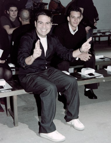Designer Narciso Rodriguez sits front row before the beginning of his Fall 2001 fashion show.
