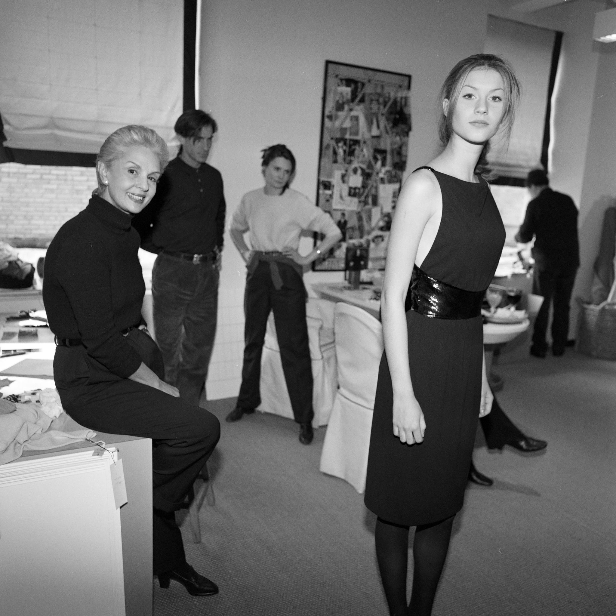 Designer Carolina Herrera and staff in fall fitting with model Gisele Bundchen.