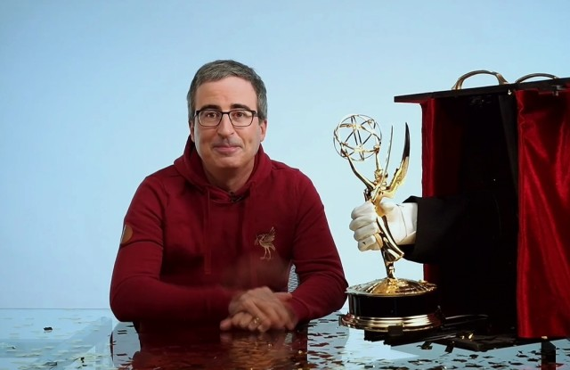 """John Oliver from """"Last Week Tonight with John Oliver"""" accepts the Emmy for Outstanding Variety Talk Series during the 72nd Emmy Awards telecast on Sunday, Sept. 20, 2020 at 8:00 PM EDT/5:00 PM PDT on ABC. (Invision for the Television Academy/AP)"""