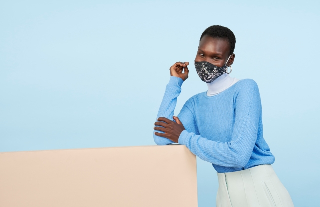 A model wears a mask from Prabal Gurung's Impower brand.