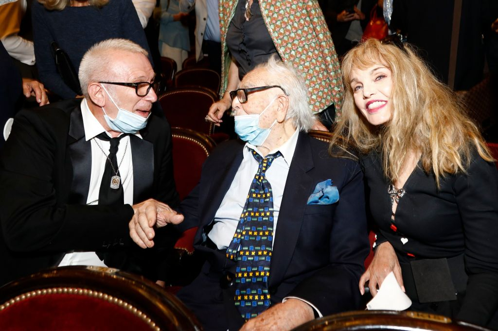 "Pierre Cardin (C) talks with French Designer Jean-Paul Gaultier (L) and Arielle Dombasle (R) during the ""House Of Cardin"" Special Screening at Theatre du Chatelet on September 21, 2020 in Paris, France. (Photo by Julien M. Hekimian/Getty Images for Pierre Cardin)"