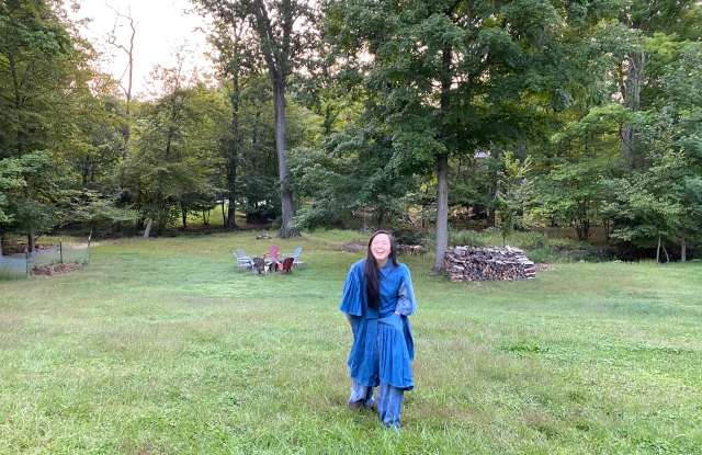 Kyra Buenviaje wearing her upcycled denim designs in her Rockland County, N.Y. backyard.