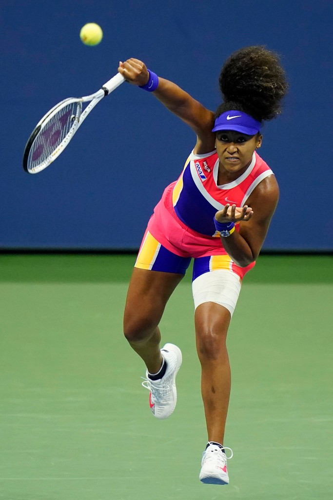 Naomi Osaka, of Japan, serves to Anett Kontaveit, of Estonia, during the fourth round of the US Open tennis championships, Monday, Sept. 7, 2020, in New York.