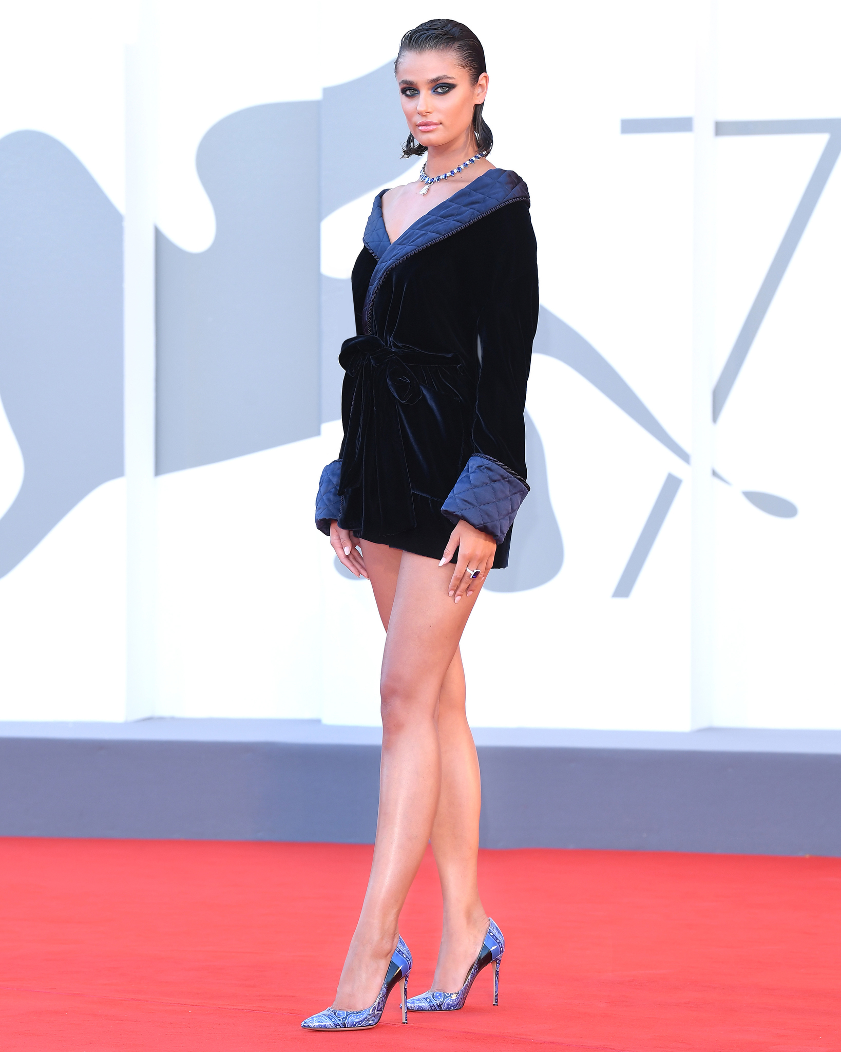 "Taylor Hill on the ""Amants"" red carpet at the 77th Venice Film Festival."