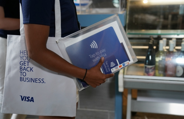 The Visa Back to Business Street Team visits Kouzina Christos, a Greek restaurant, on Monday, June 29, 2020 in Atlanta. Kevin D. Liles/AP Images for Visa)